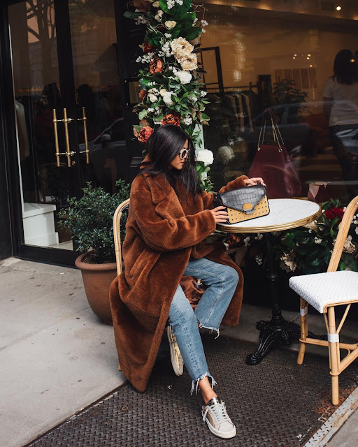 Faux fur coat in brown