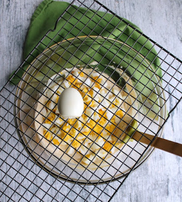 using squares of cooling rack to dice hard boiled eggs for salad