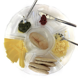 ingredients for pitta pizzas in a tray