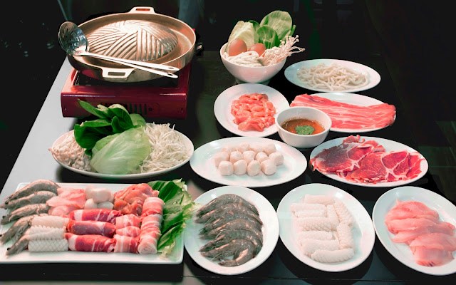 Image of Thai BBQ cooker, enokitake, kailan, fishballs, sliced beef, bacon strips, noodle, cuttlefish, sliced fish, prawns, rolled up meat platter