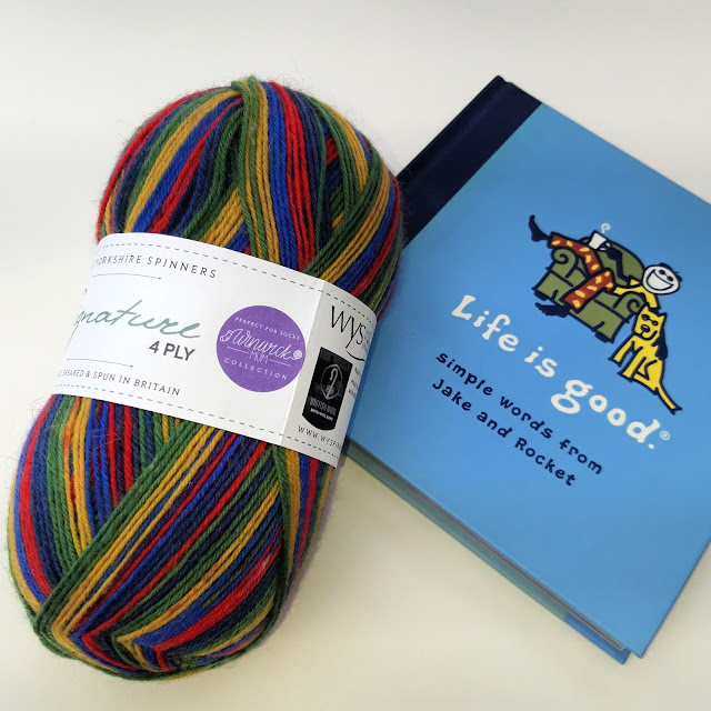 "A ball of Brightside yarn and a book entitled ""Life is Good"""