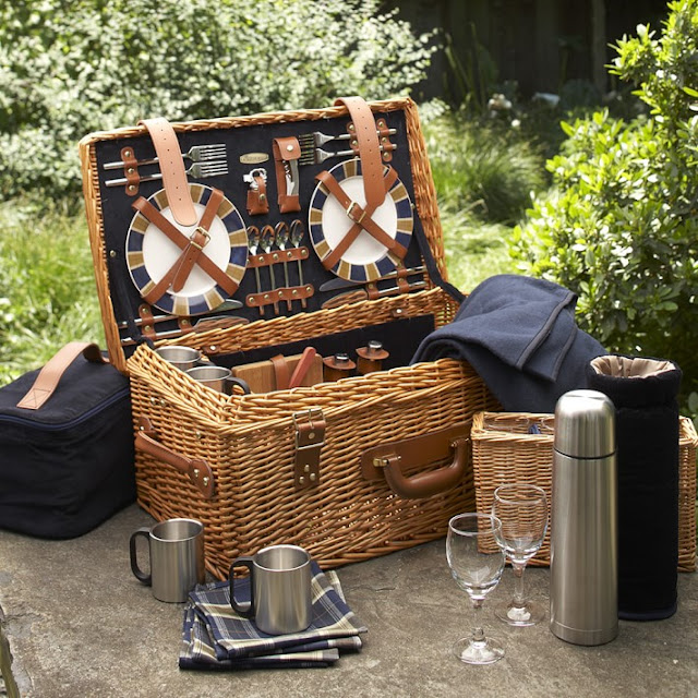 Picnic basket with all the necessities: plates, flatware, wineglasses...