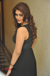 Actress Surabhi Stills in Black Long Dress at turodu Audio Launch  0056.JPG
