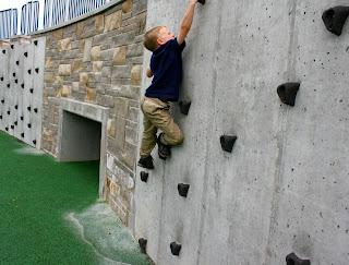 Climbing a rock wall.