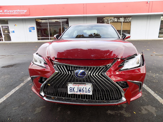 2019 Lexus ES300h with front end damage at Almost Everything Auto Body.