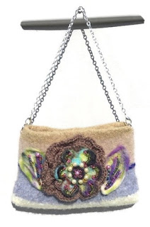 https://www.andreawagnerdesigns.com/collections/coin-purses/products/the-chocolate-rose-felt-bag-felt-purse-hand-knitted-beige-gray-and-tan-wool-handbag-womens-shoulder-bag-boho-chic-style