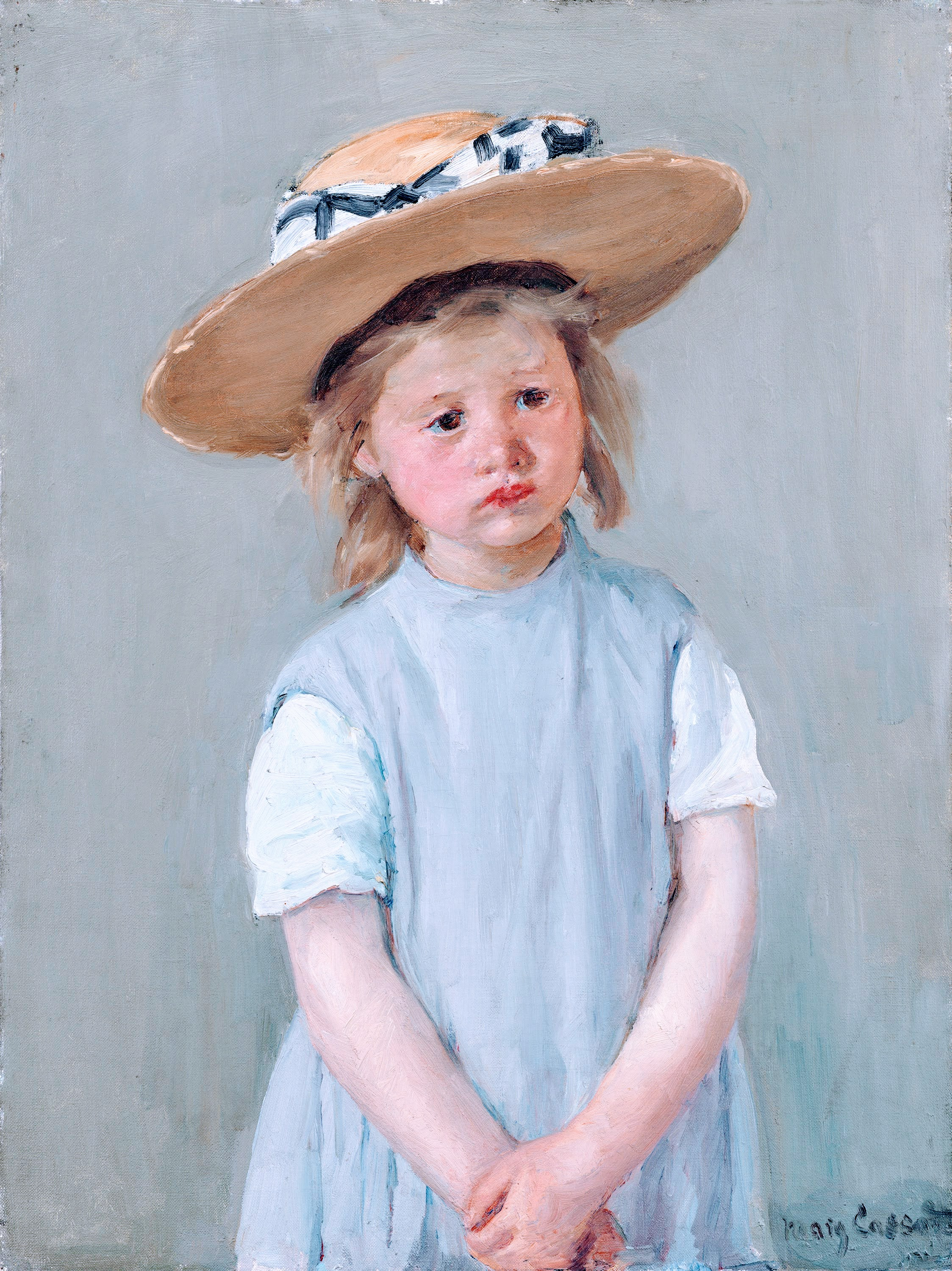 Little girl in a straw hat