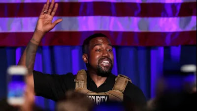 Kanye West wears bulletproof vest to rally  - Kanye West confesses 'I virtually killed my daughter' as he sobs at marketing campaign rally