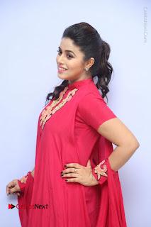 Actress Poorna Latest Stills in Red Dress at Rakshasi First Look Launch  0072.JPG