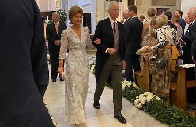Princess Marie Astrid wore the Kinsky Honeysuckle tiara from the collection of the Princely Family of Liechtenstein. Wedding dress