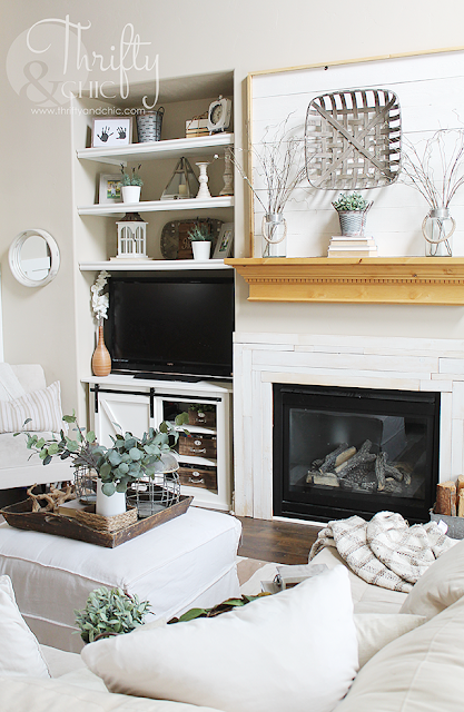 http://www.thriftyandchic.com/2011/09/diy-fireplace-surround.html