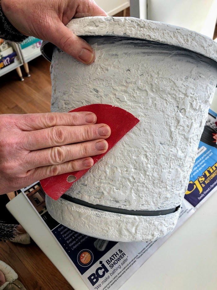 sanding joint compound on pot