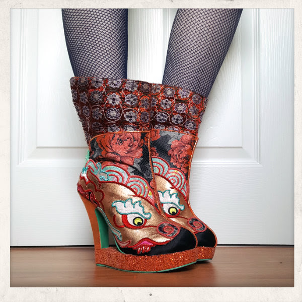 wearing Irregular Choice Tatsu ankle boots with cuff worn up