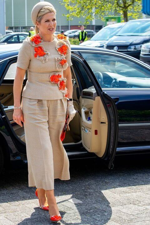 Queen Maxima's outfit is from the fashion house Natan. Natan top and trousers