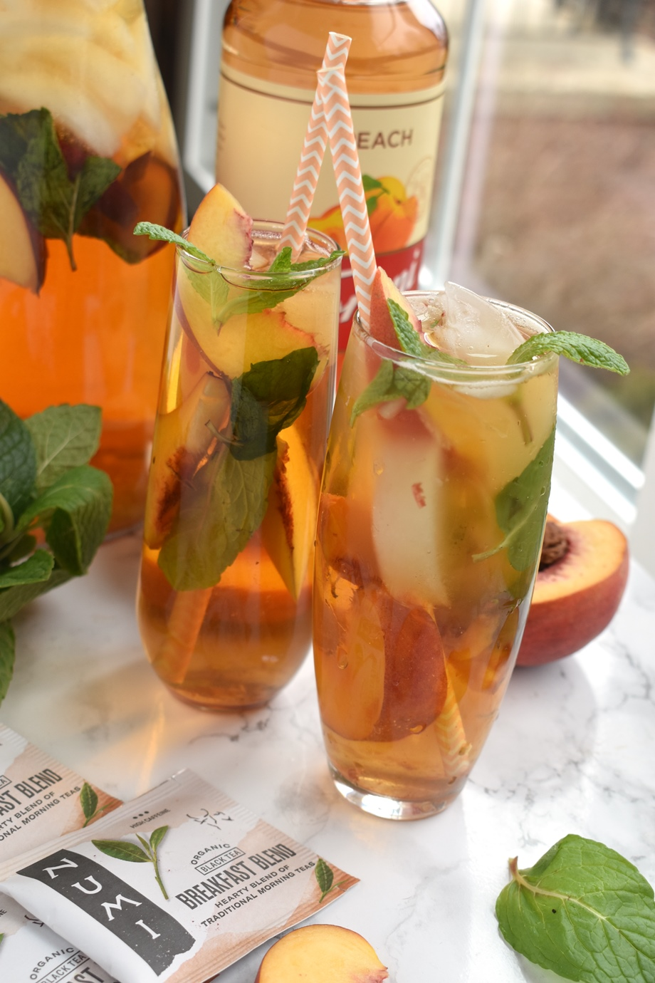 Peach mint iced tea with peaches and mint