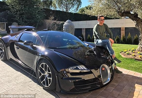 Check out Cristiano Ronaldo's astonishing collection of cars including 3 Porsches, 2 Bugattis, 2 Ferraris & they are worth almost £6m (Photos)