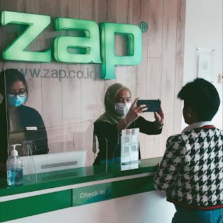 At ZAP reception desk.jpg