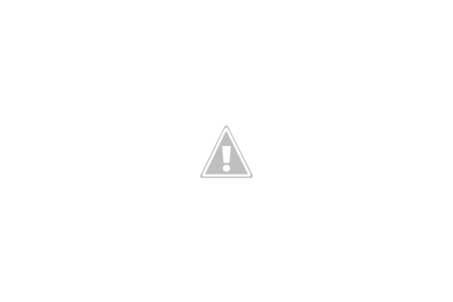 Woman grasping head beside car