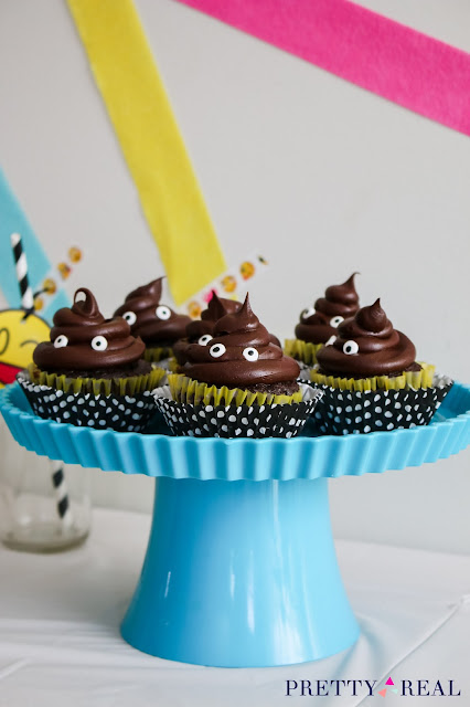 modern emoji party with poop emoji cupcakes
