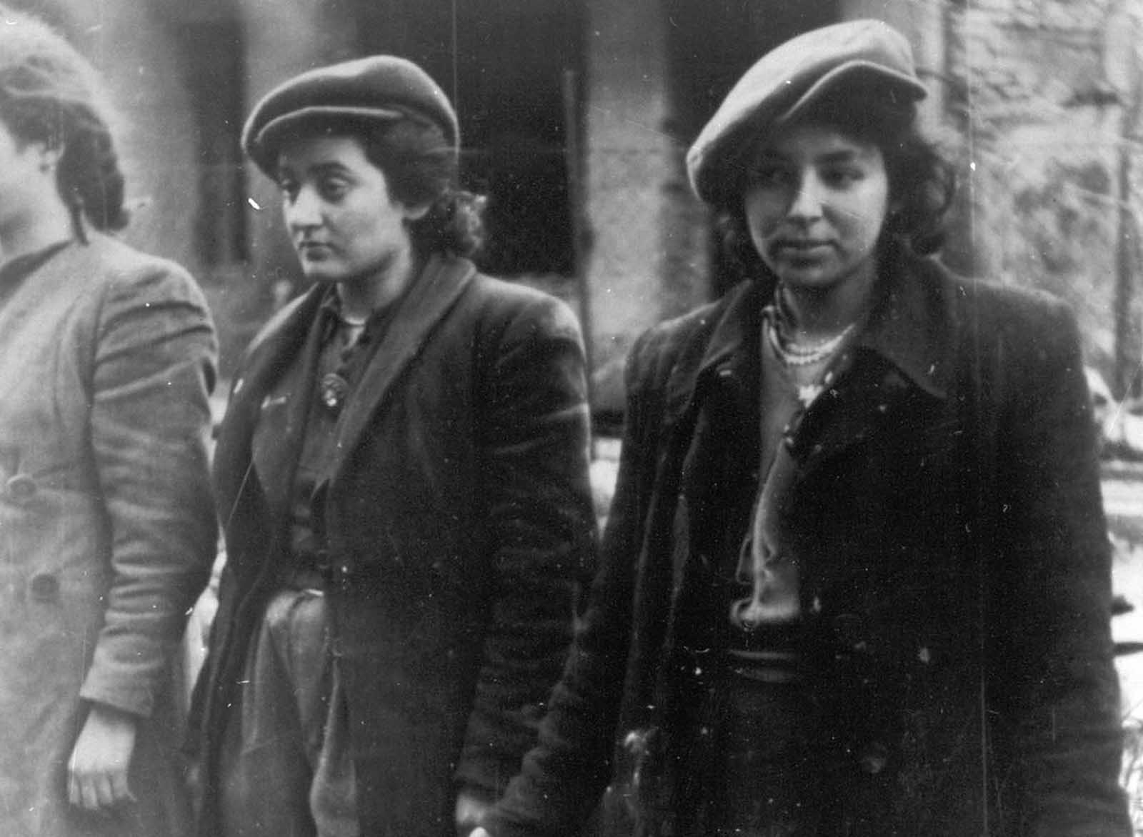 A group of young Jewish resistance fighters are being held under arrest by German SS soldiers in April/May 1943, during the destruction of the Warsaw Ghetto by German troops after an uprising in the Jewish quarter.