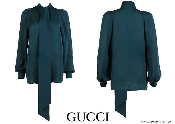 Queen Maxima wore Gucci emerald green silk blouse