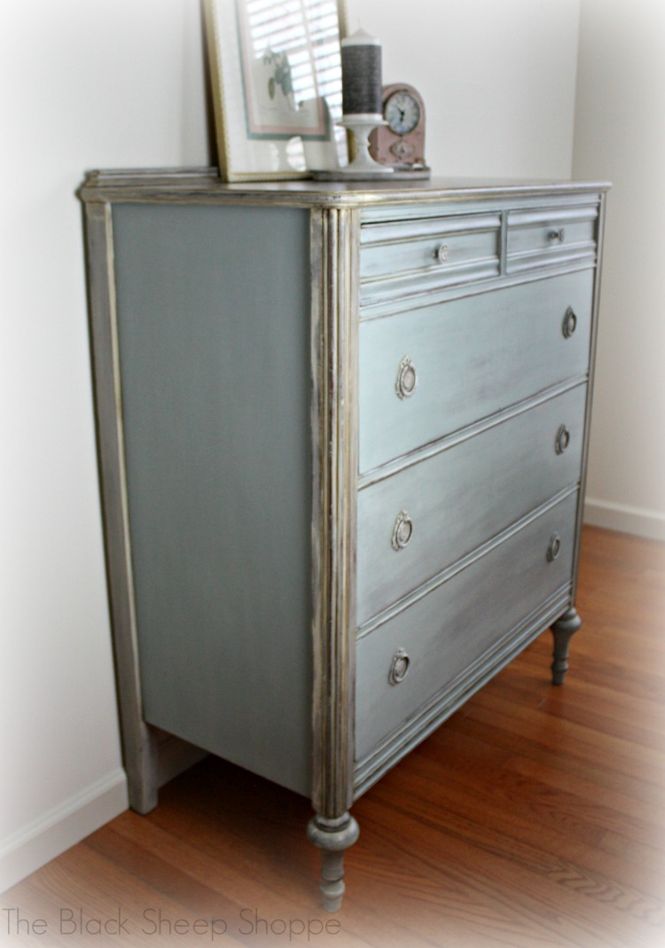 Custom mix of Duck Egg Blue and Paris Grey was applied to the side panels and drawer fronts.