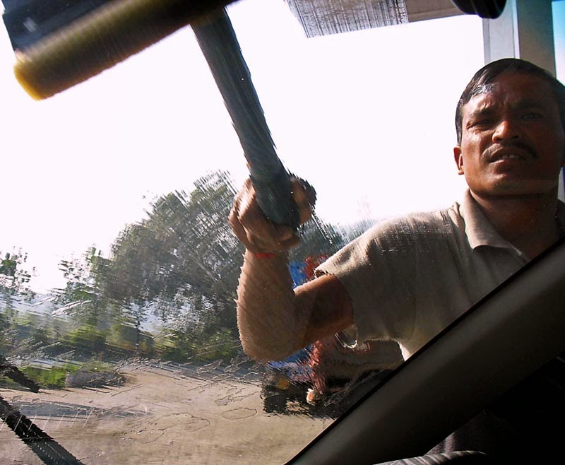 windshield wiper man with sponge or squeegee