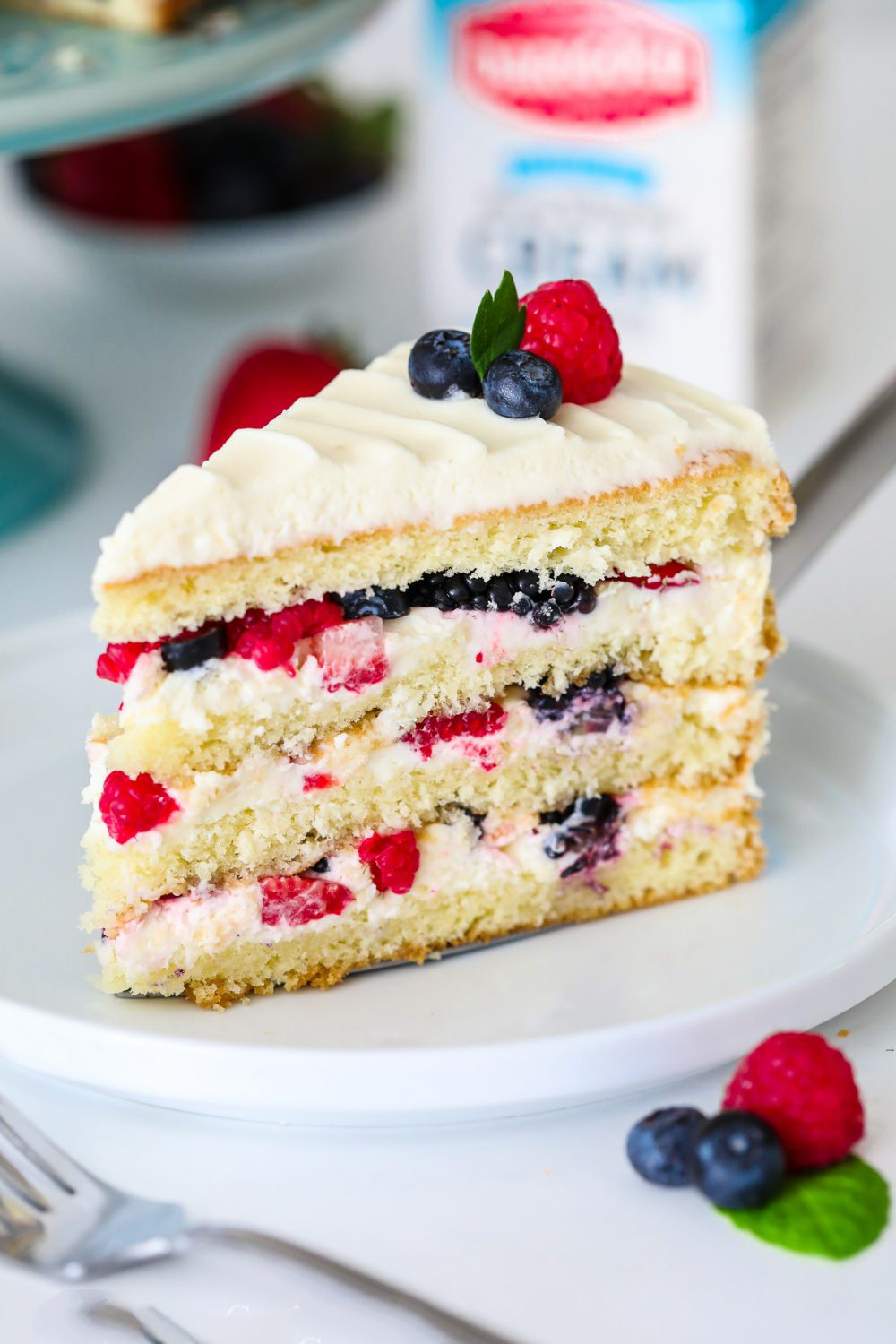 Berry Chantilly Cake - This Chantilly berry cake recipe loaded with 4 different berries, sweet mascarpone cream cheese frosting, and 4 fluffy vanilla cake layers.