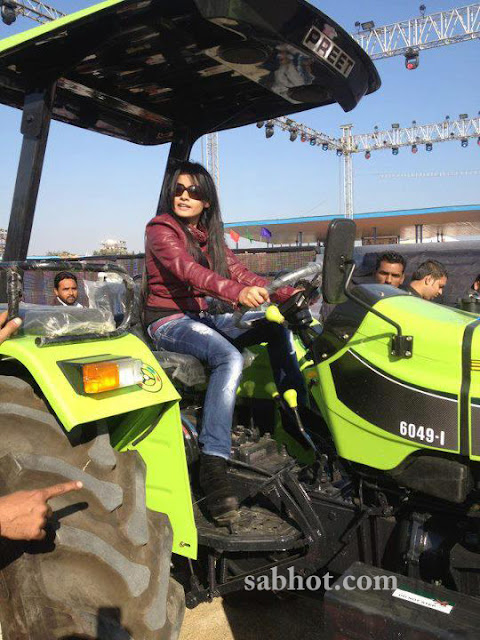 Miss pooja unseen pictures on tractor