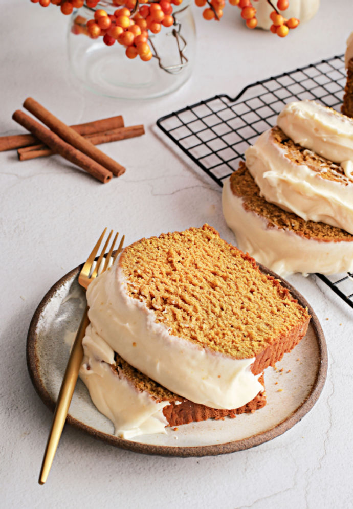 Recipe for a fluffy, flavorful pumpkin loaf cake topped with salted caramel cream cheese frosting.