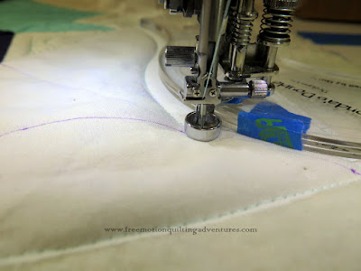 Quilting with rulers on a domestic sewing machine-using a double S curve ruler for crosshatching