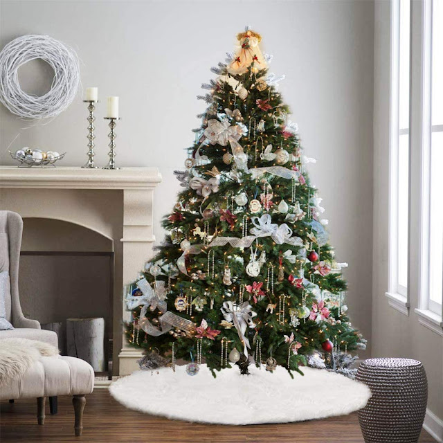 glamorous Christmas tree white tree skirt fireplace candlesticks