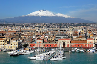 Etna looms large over the port city of Catania, with the outskirts just 15km from the summit