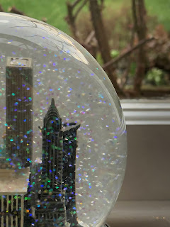 A snow globe in front of a window