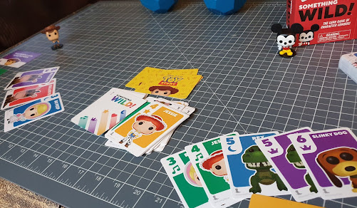 Funko Disney Something Wild! Card Games review Toy Story and Mickey Card gameplay set up on table