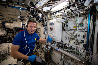 Drew Morgan giving a thumbs up aboard the ISS