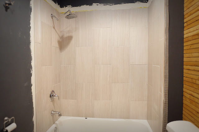 shower tile large format 12x24 surround tub after