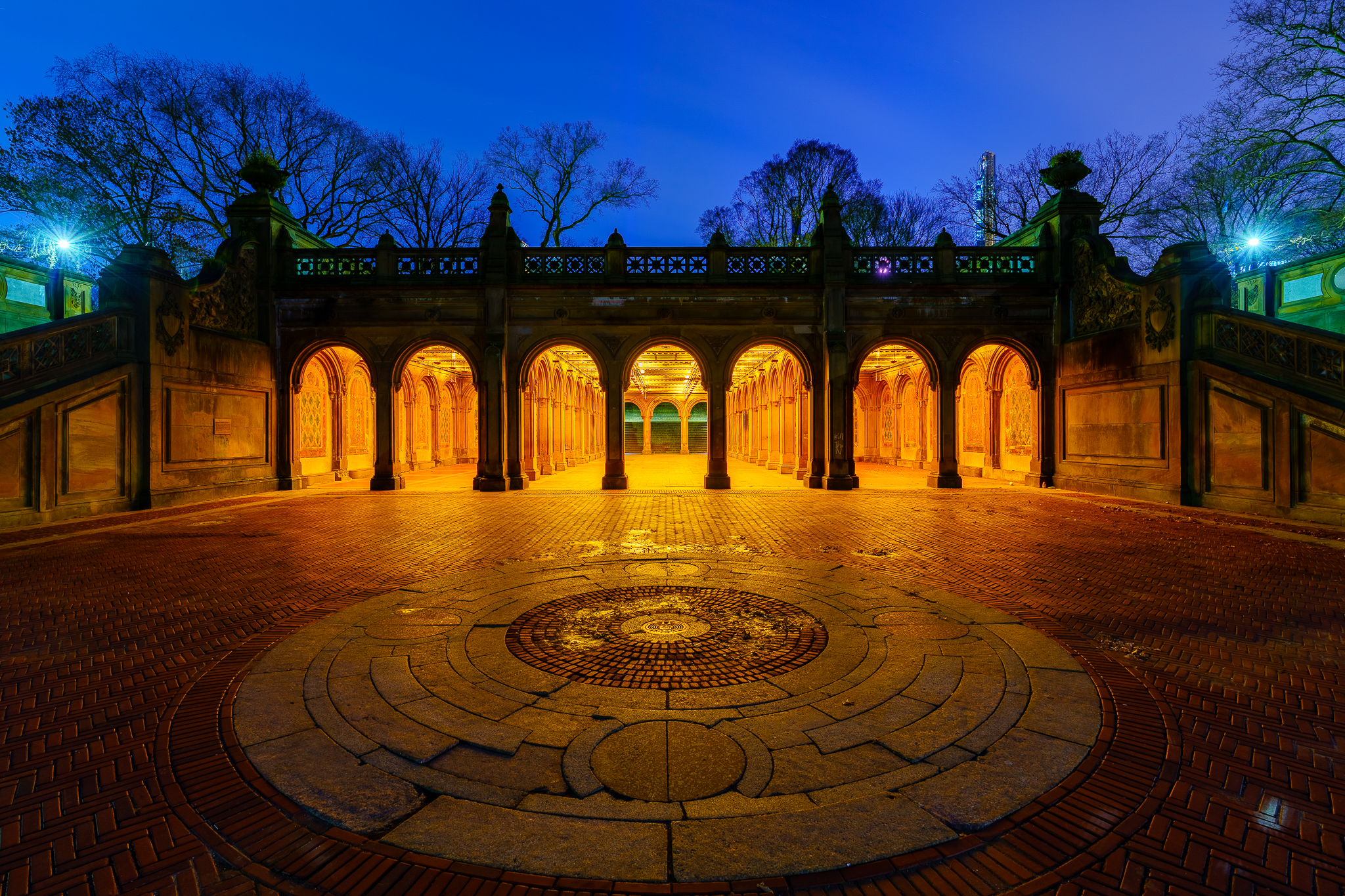 a photography of bethesda terrace in central park new york at night