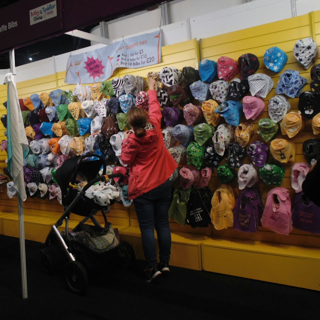 Funky giraffe stand , the baby and toddler show