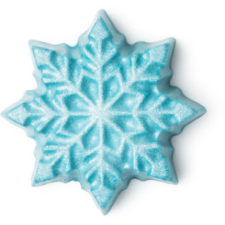 A icy silver blue snowflake shaped massage bar on a bright background