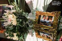 casamento com cerimônia com missa no santuário mãe de deus em porto alegre e recepção no salão por-do-sol da aabb porto alegre com decoração simples e sofisticada elegante em verde e branco com detalhes em vidro com organização projeto e cerimonial de life eventos especiais imagem do pai no bouquet