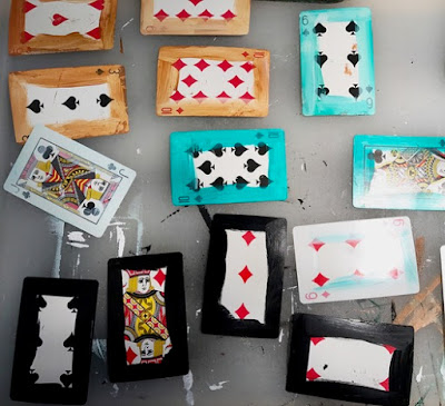 Playing cards prepped for collage