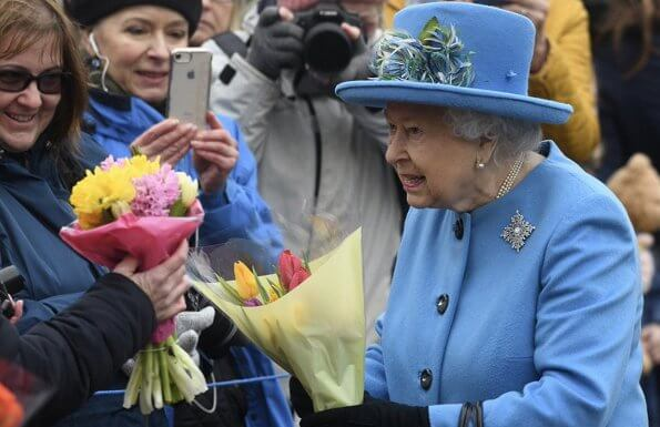 Queen Elizabeth wears her Canadian snowflake brooch. This Sapphire brooch was given to the Queen on behalf of the Canadian people