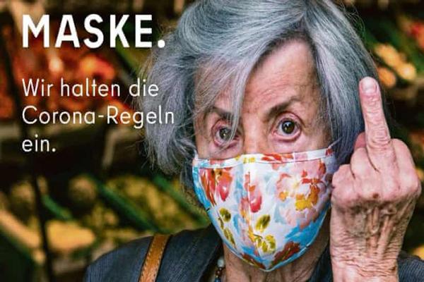 Berlin zeigt Anti-Maskenbildnern in Tourismusagentur-Anzeige den Mittelfinger