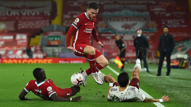 Andrew Robertson of Liverpool takes evasive action at Anfield