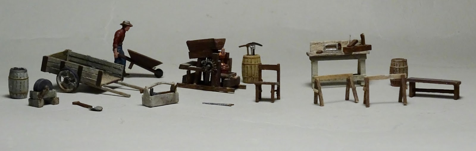 scratch built as are the chair bench work bench saw horses and the strange machine in the center that machine is being repaired by the carpenter  [ 1600 x 509 Pixel ]