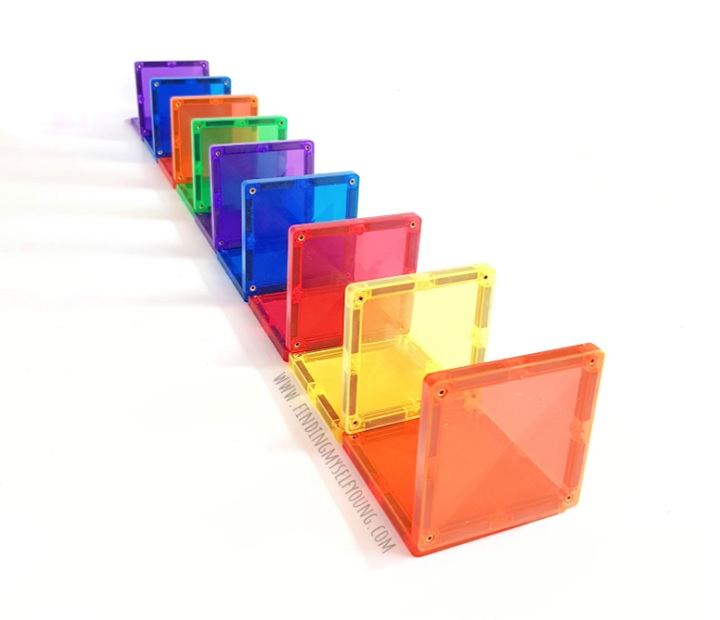 square magnetic tiles lined up as dominos
