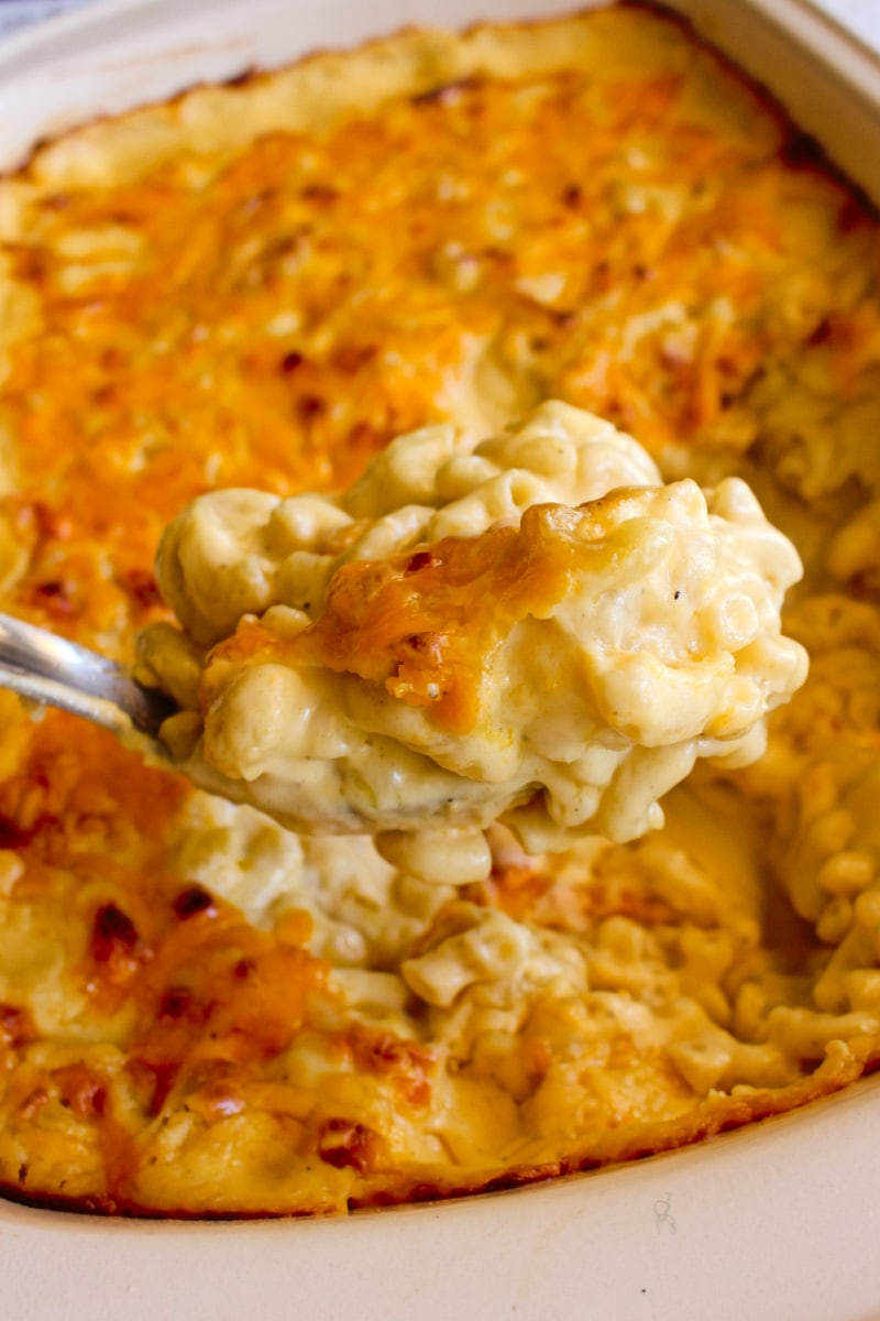 This Extra Creamy Baked Macaroni and Cheese recipe is made with an irresistibly rich and silky cheddar cheese sauce. It is the creamiest, cheesiest baked mac and cheese ever!