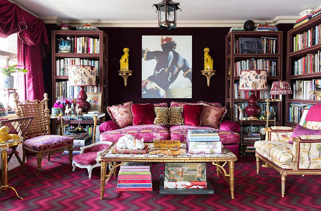 In the library, a custom-made sofa and a custom-made cocktail table by John Rosselli Antiques, a chevron carpet of Langhorne and work of art by Rob Wynne | Alex Papachristidis's Manhattan apartment