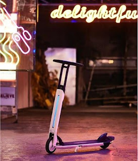 Stylish electric scooter against neon background